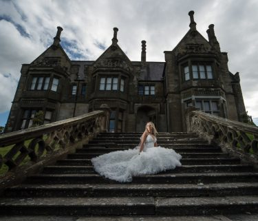 Brownlow house wedding photography bride on step