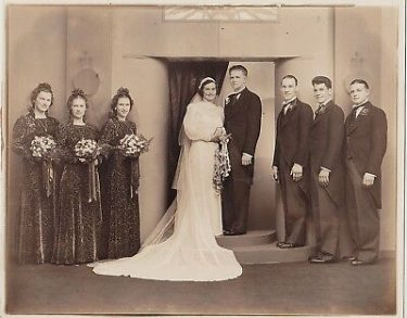 Old Sepia photograph of a wedding in 1940s